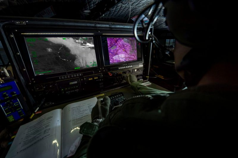 Professional FLIR system operator working at the console